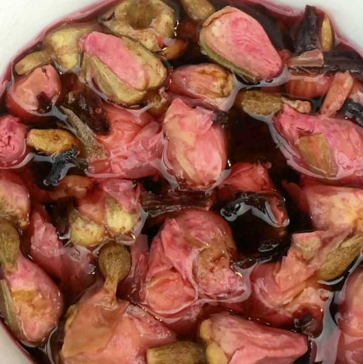 close-up photo of rosebuds and hibiscus steeping to make tea