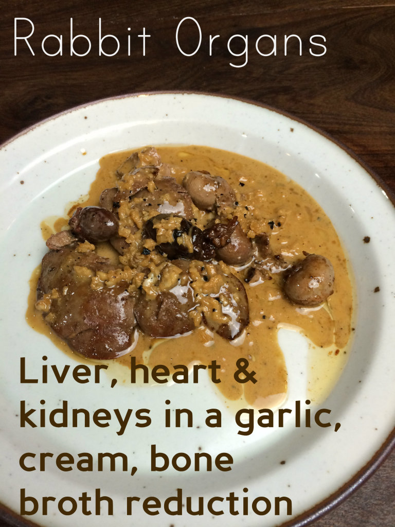 Being a good Weston A. Price follower I dutifully eat my organ meats and feed them to my family.  The rabbit organ meat we recently ate, however, was, hands down, the best organ meat I have ever enjoyed.  So, if you're raising rabbits for meat, or buying rabbits from a local farmer, don't neglect these gems.  The livers are small compared even to chicken livers, in their thickness.  So the texture is more subtle and delicate.  The kidneys are mild and yet flavorful, pleasant in texture.  The hearts, well, almost everyone loves hearts.  They're a muscle after all; so they taste meaty.  They are a bit chewy, but in a nice way, and can be cooked to medium, not well-done.  This garlic reduction sauce I made was bordering on heaven.
