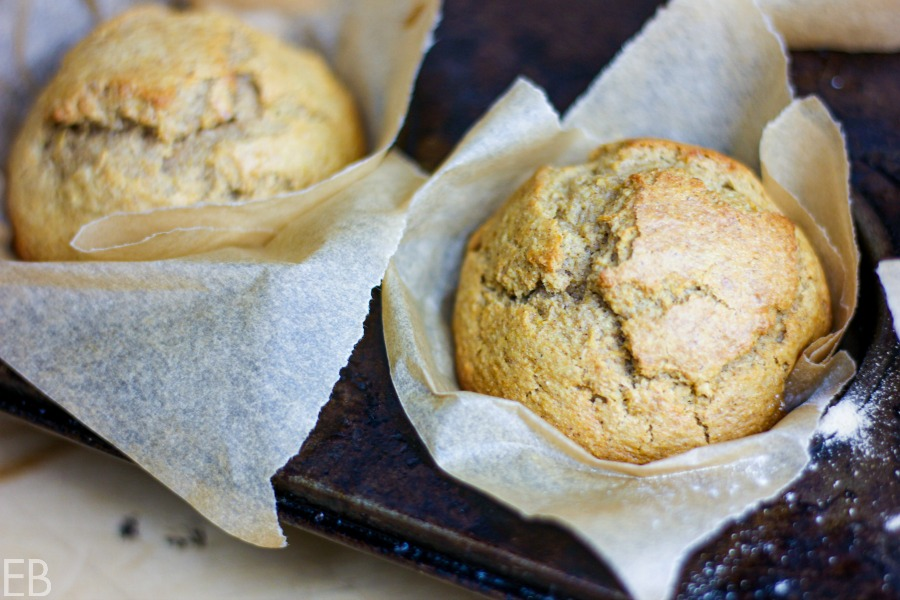two butternut squash muffins in pan