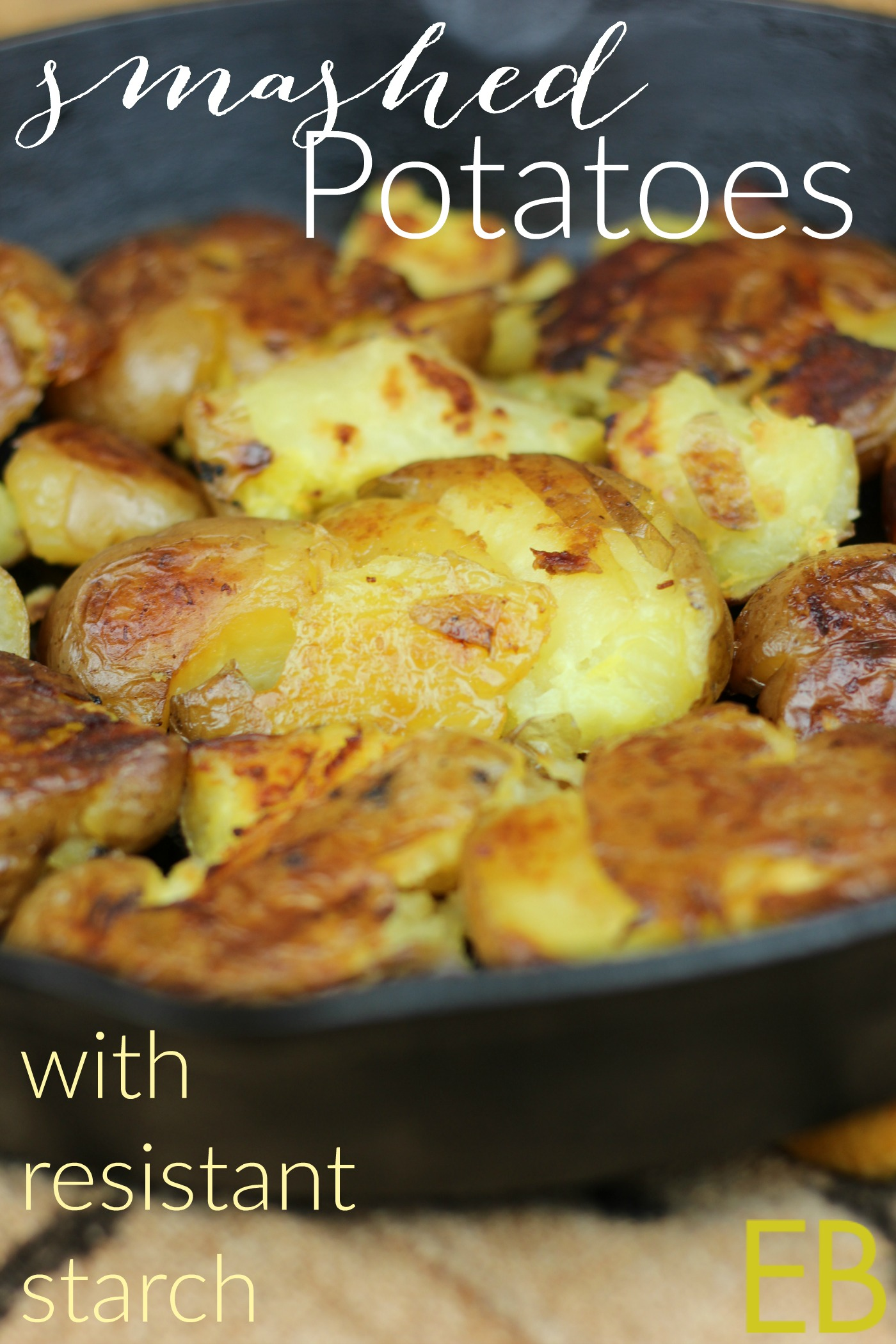 cast iron skillet with golden smashed potatoes inside that are paleo and whole30