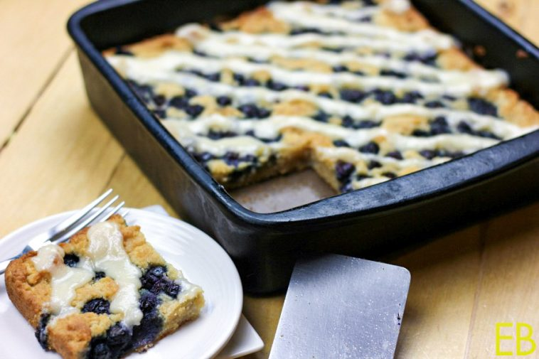 a big square cut out of a aip and paleo lemon blueberry coffeecake and served on a small white plate