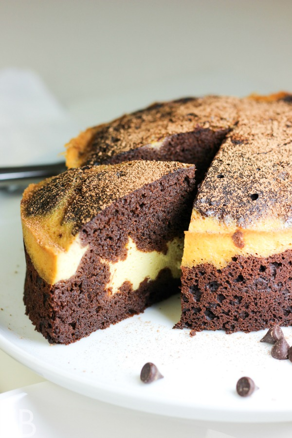 One slice of cream cheese filled chocolate cake being served with ganache. This cake is primal grain-free and gluten-free.