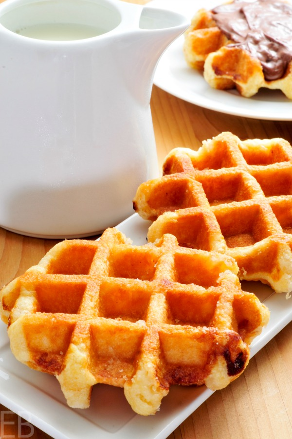 3 sourdough paleo cassava waffles with a jug of syrup and one with chocolate on top