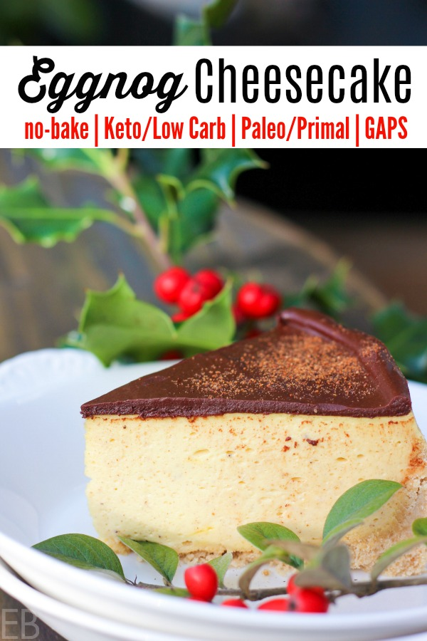 slice of eggnog cheesecake with chocolate ganache on top, on white plate, keto and paleo