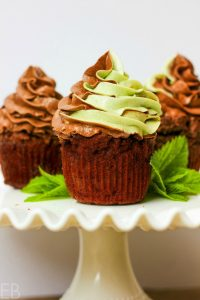 three chocolate mint cupcakes on a white platter