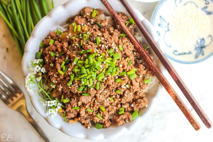 overhead view of asian beef bowl with chopsticks