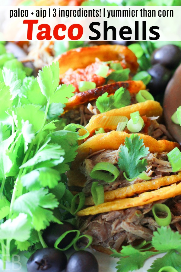 a row of paleo aip taco shells with shredded meat inside and fresh cilantro