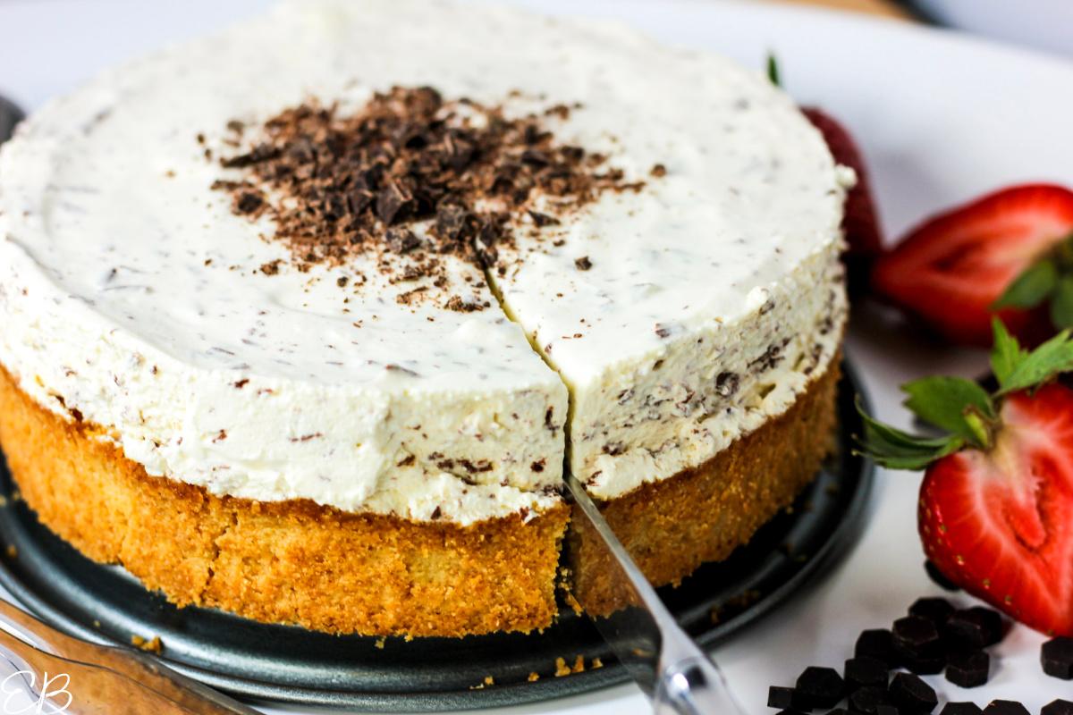 slicing into no bake chocolate chip cheesecake