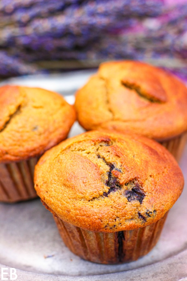 3 paleo blueberry-banana muffins on a pewter plate