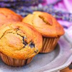 a pewter plate topped with blueberry-banana muffins