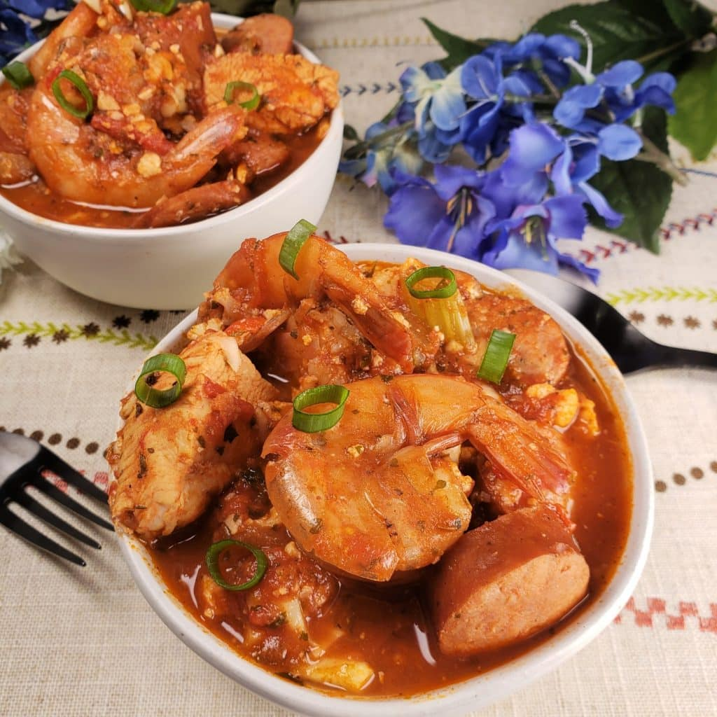 keto jambalaya for super bowl meal served in two white bowls