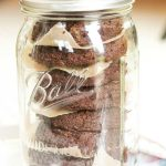 aip chocolate banana cookies stacked in a mason jar for storage
