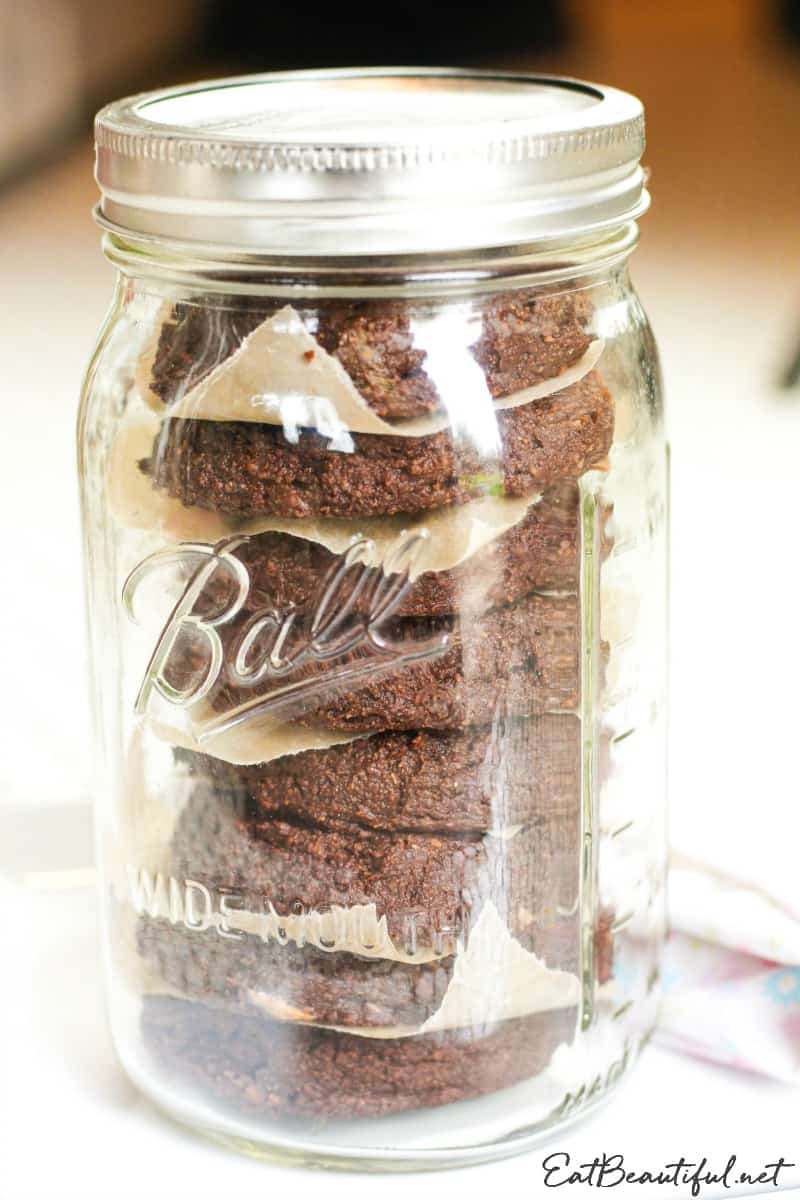 mason jar filled with stacked aip chocolate banana cookies for storage