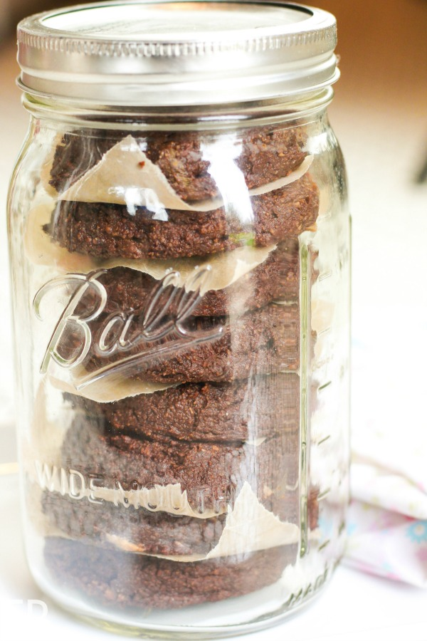 aip healthy chocolate banana cookies stacked and stored inside a mason jar