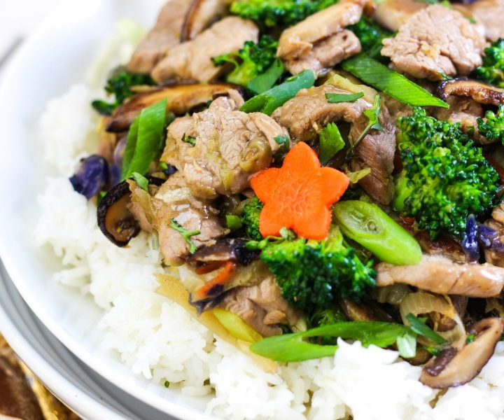 a broad bowl with whole30 aip paleo gaps chinese hot and sour stir fry inside: pork tenderloin slices, broccoli, green onions and a stamp that says 20 minutes one pan