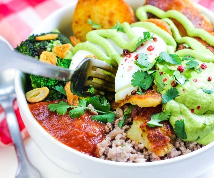 white bowl full of whole30 paleo meat broccoli garlic salsa and crispy potatoes