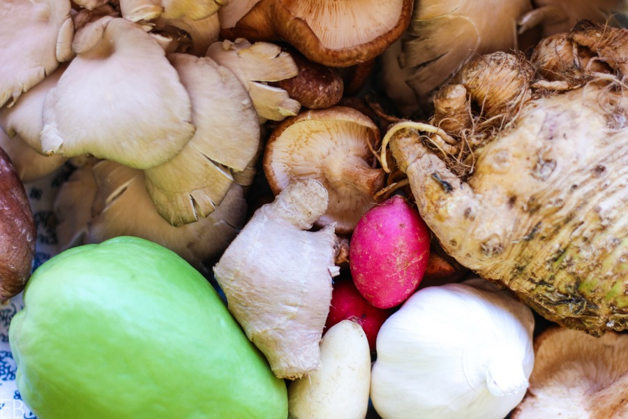 a group of vitamin a detox foods including a radish, mushrooms and ginger
