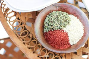 a small copper bowl of za'atar spices