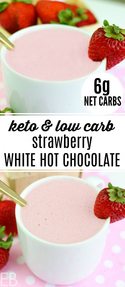 mug of pink strawberry white hot chocolate with fresh strawberries (keto low carb)