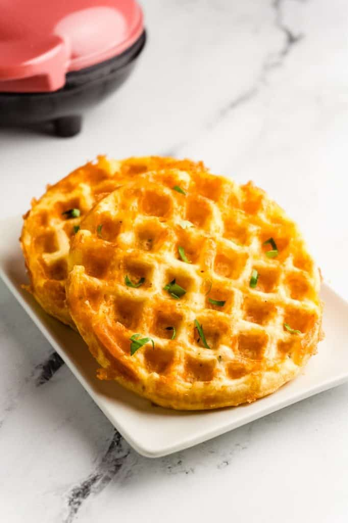 two chaffles with fresh herbs on top