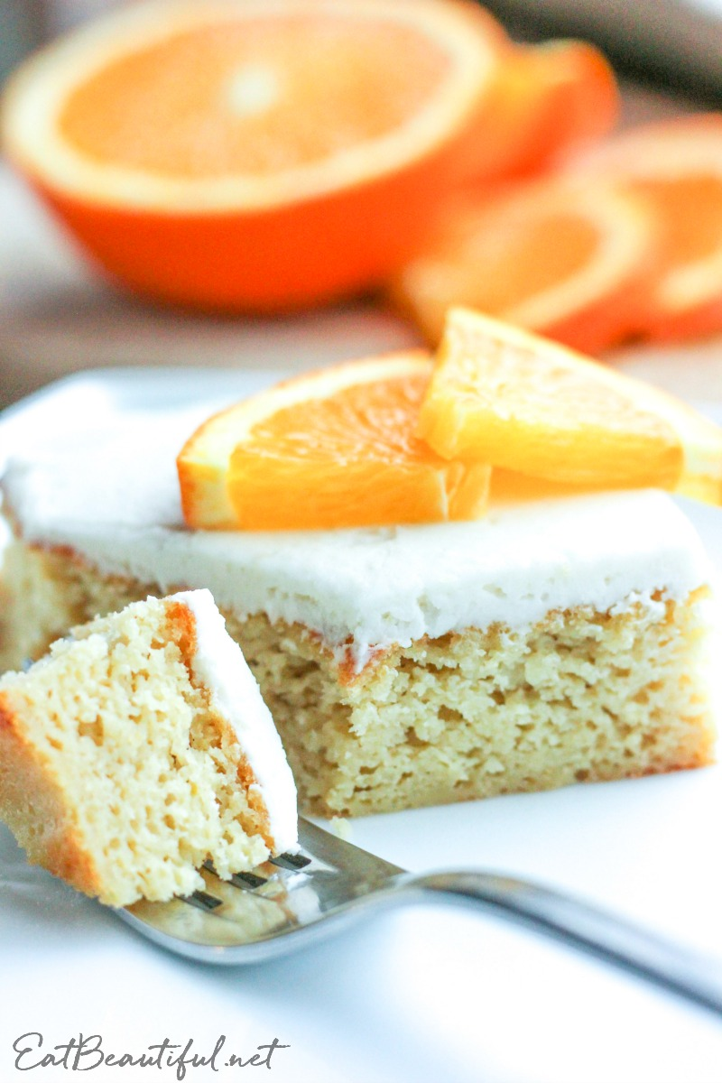 a piece of keto orange creamsicle cake with a fork
