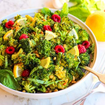 side view of roasted broccoli salad in white dish