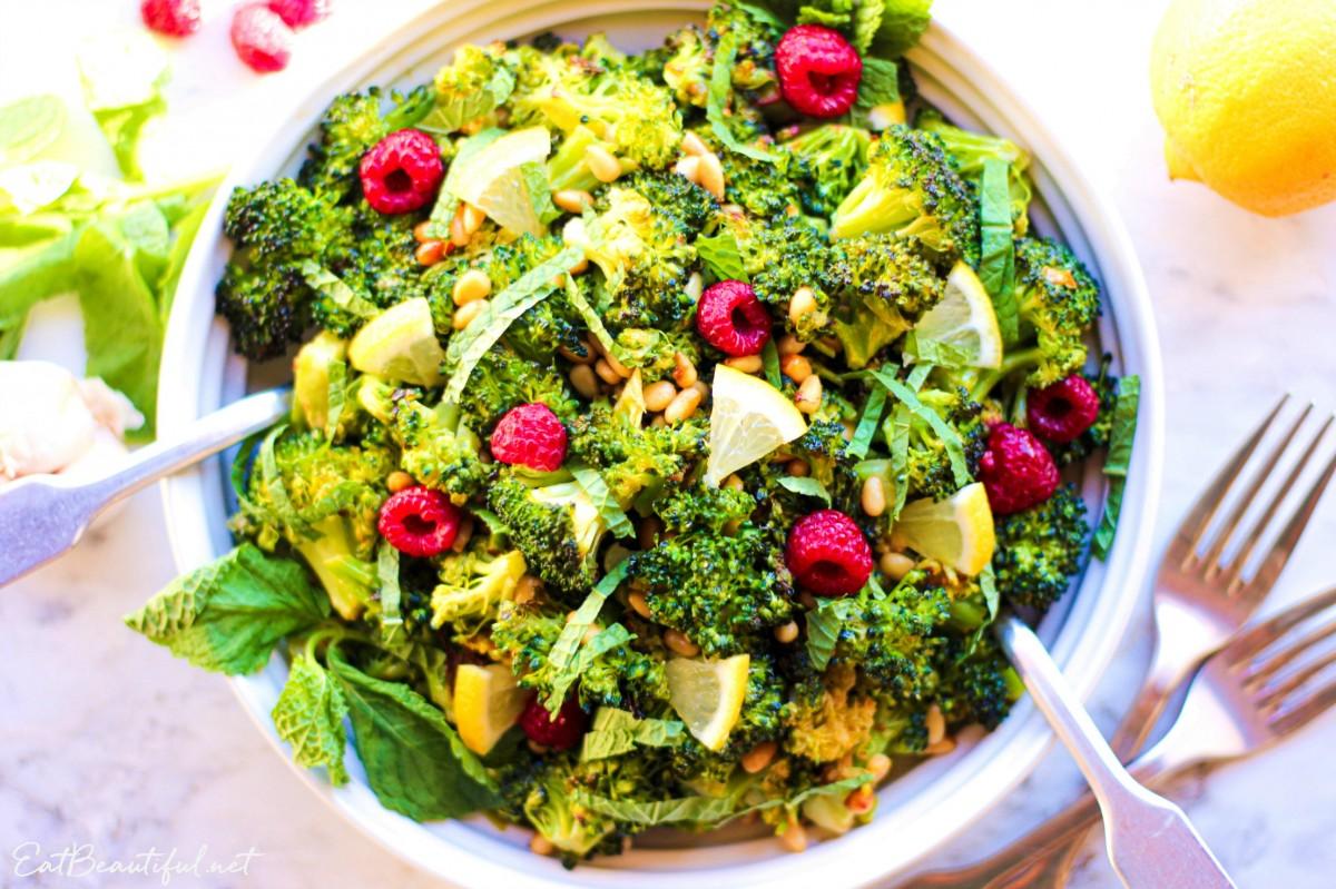 overhead view of roasted broccoli salad with raspberries and lemon vinaigrette