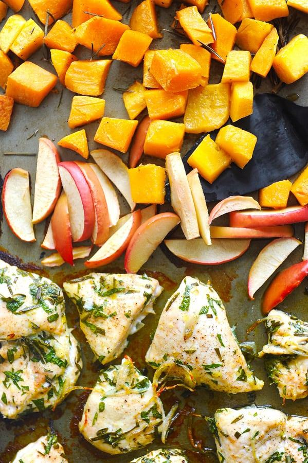 overhead view of chicken, apples and squash sheet pan dinner on pan
