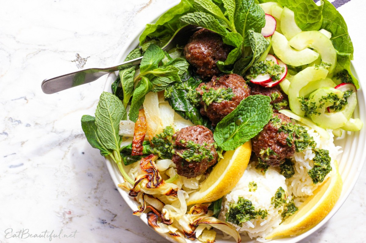 overhead view of asian meatballs bowl with lettuce and salad