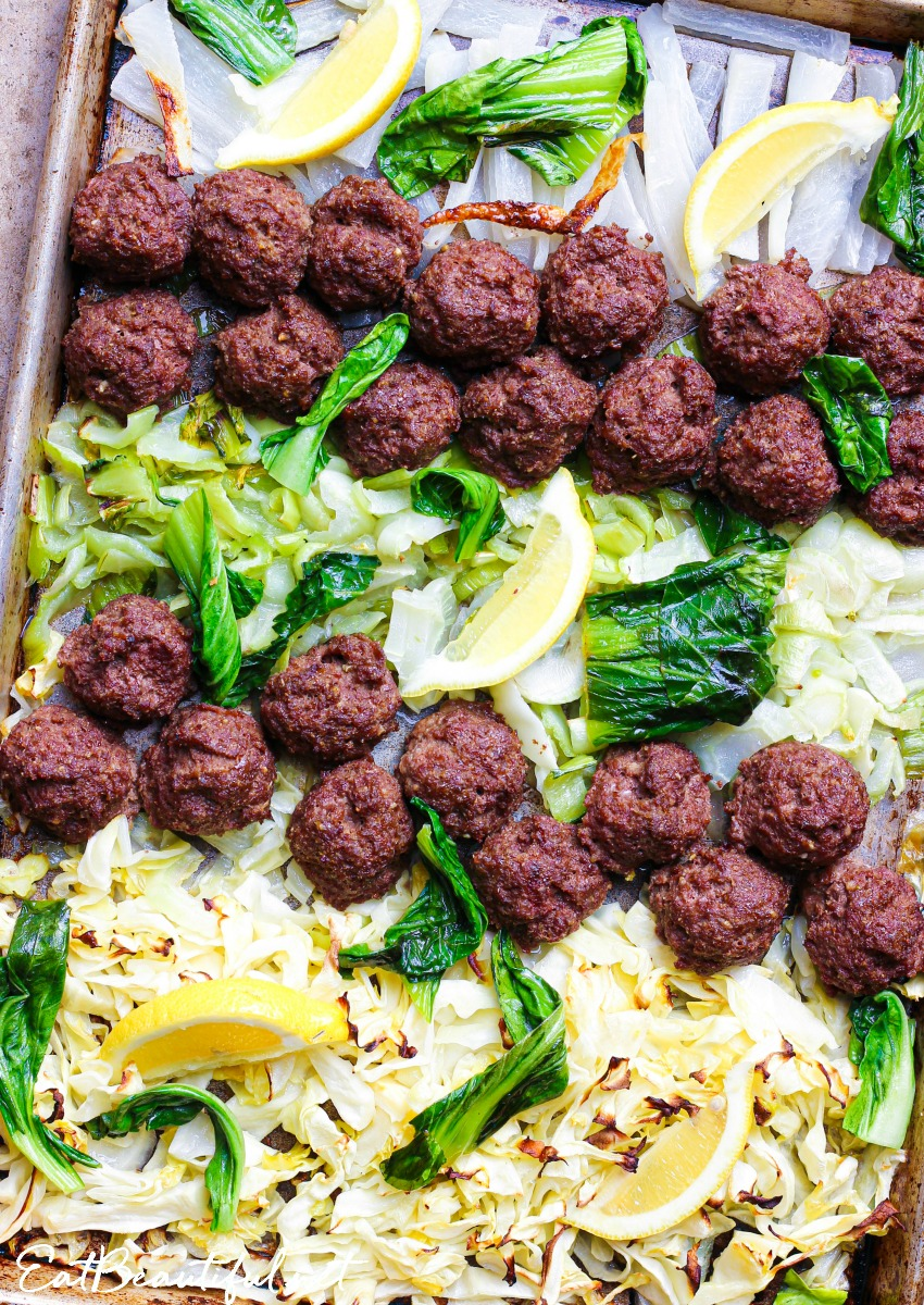 overhead view of asian meatballs dinner on sheet pan
