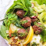 overhead view of aip paleo asian meatballs in white bowl
