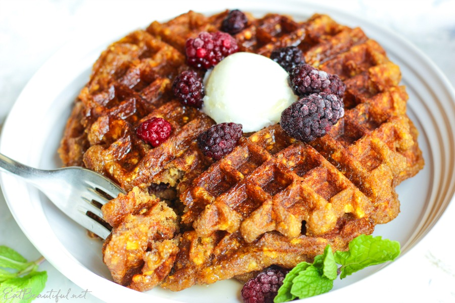 aip plantain waffles on a white plate with berries