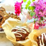 keto morning glory muffins in sunny window with flowers