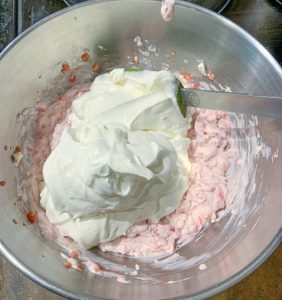 whipped cream added to the cream cheese mixture