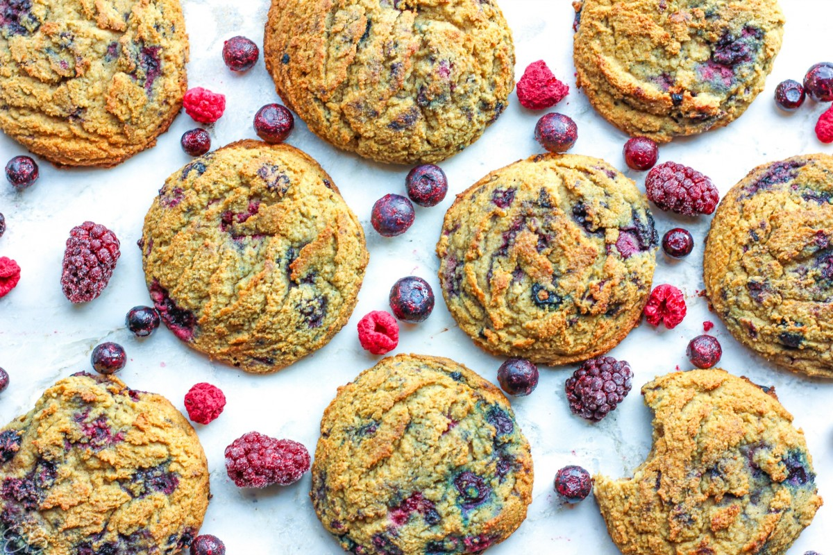 overhead view of paleo aip berry breakfast cookies with berries scattered between