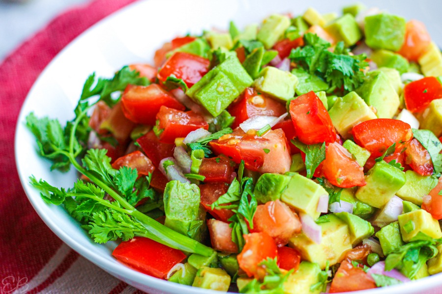 pico de gallo with avocado in white dish