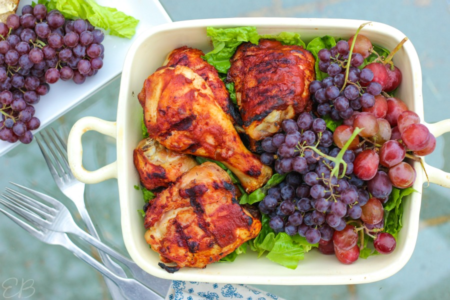 overhead view of plate with BBQ chicken and grapes