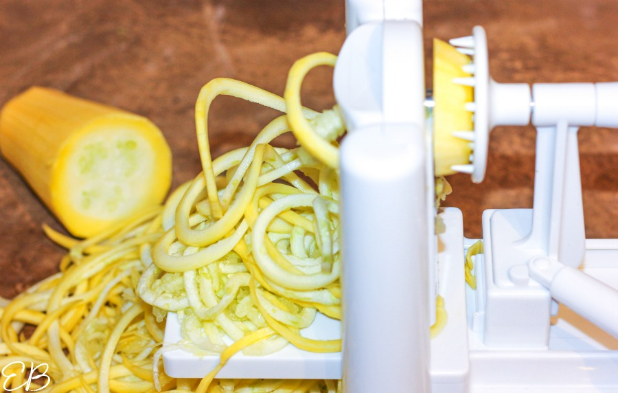 close-up view of making zucchini noodles with spiralizer