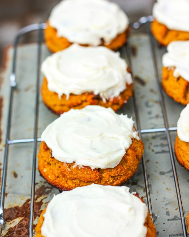 close-up view of three frosting aip pumpkin cookies