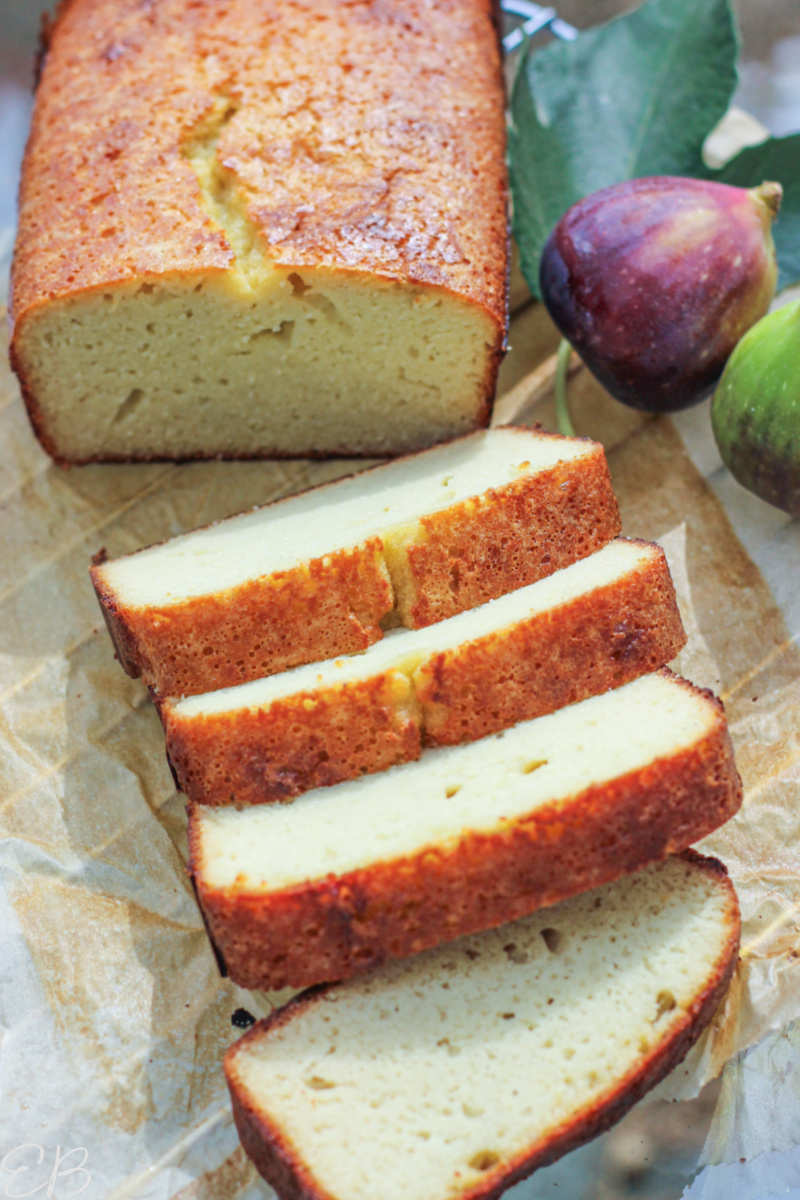 half sliced loaf of coconut flour bread with figs to one side