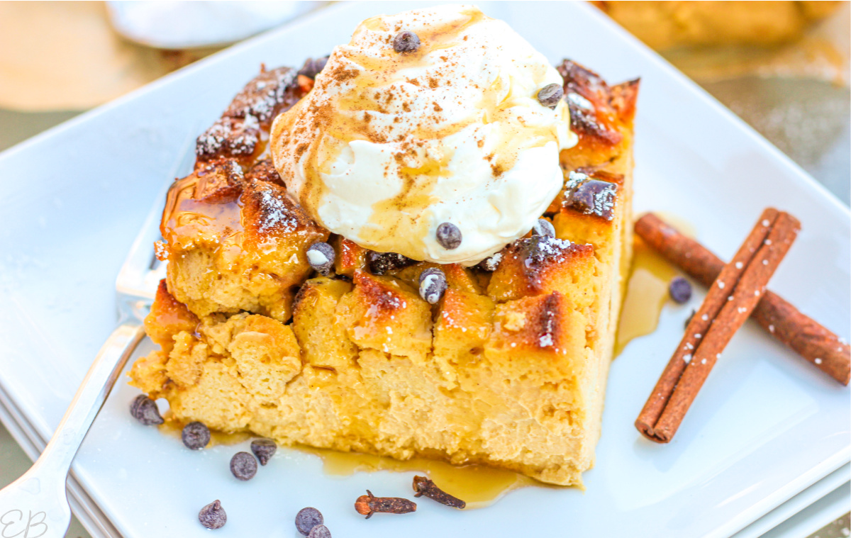 side view of large piece of bread pudding with toppings