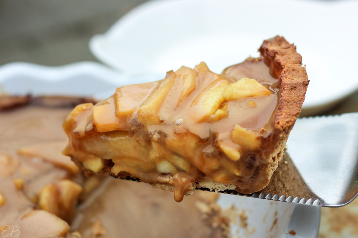 a close-up slice of aip paleo caramel apple pie in tiger nut crust