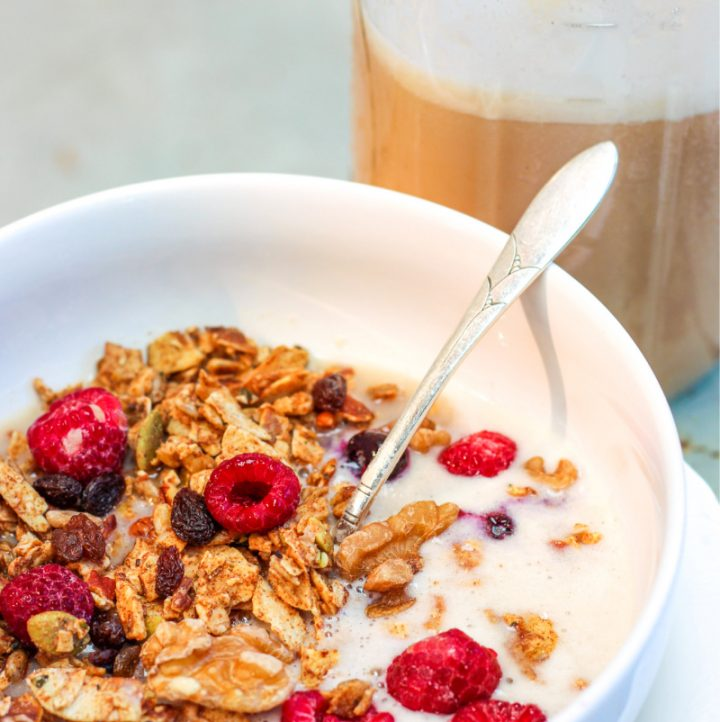 image of granola and a jar of vegan bean milk in the background