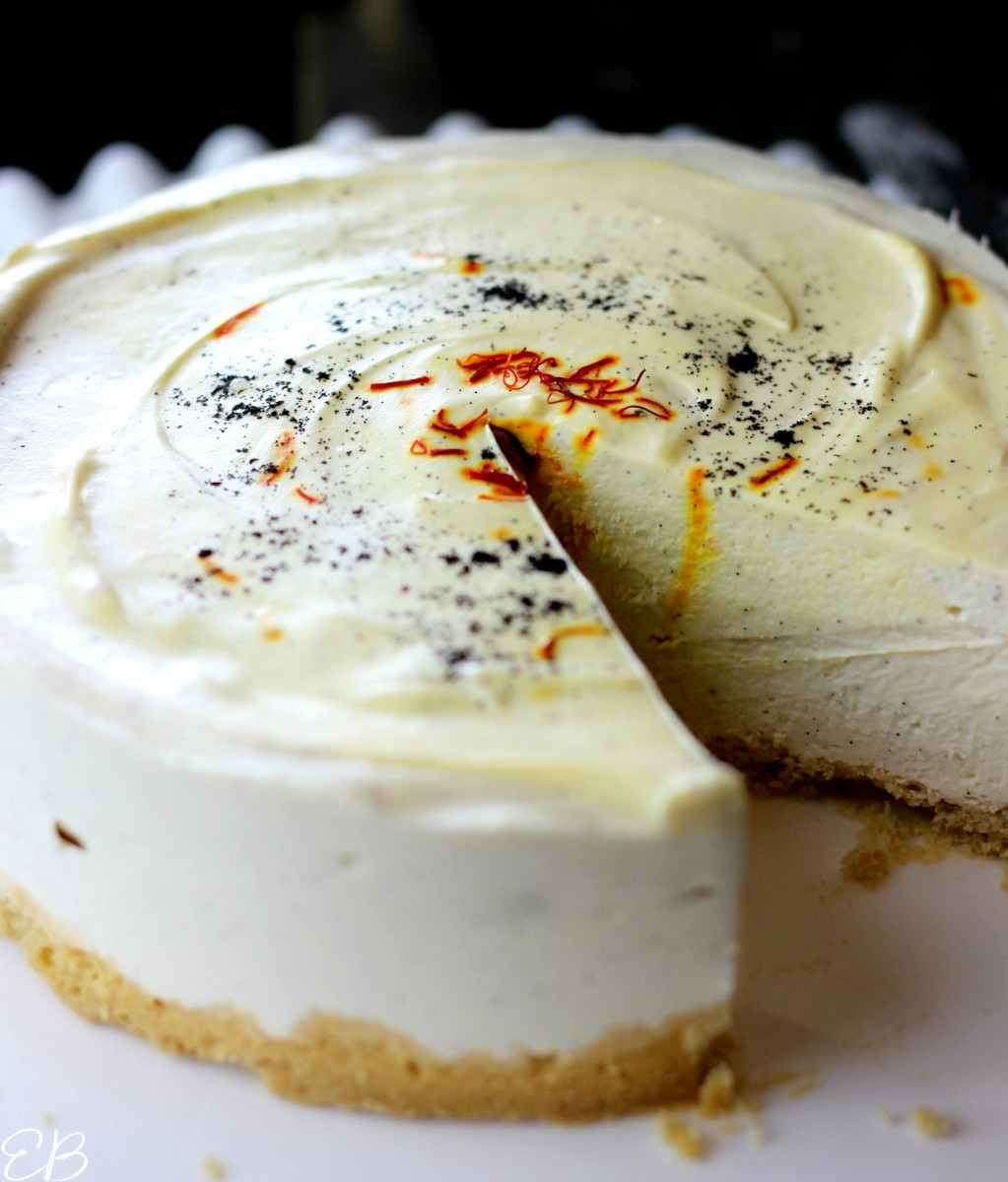 one slice removed from saffron vanilla cheesecake