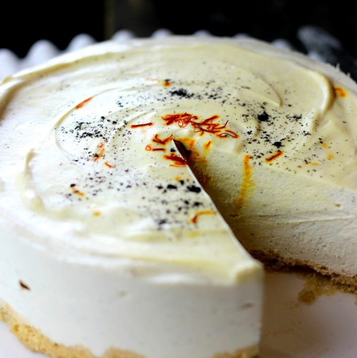 one slice out of saffron vanilla cheesecake