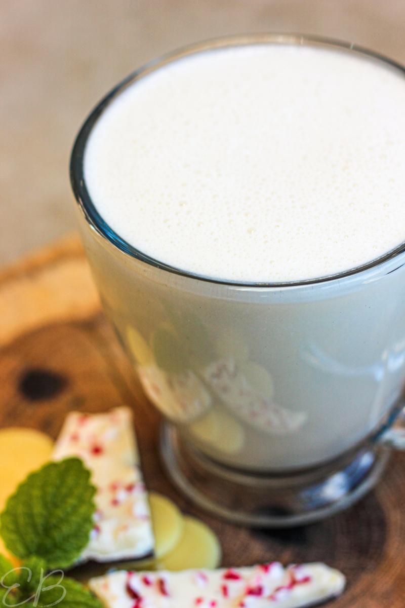 a clear mug full of peppermint white hot chocolate