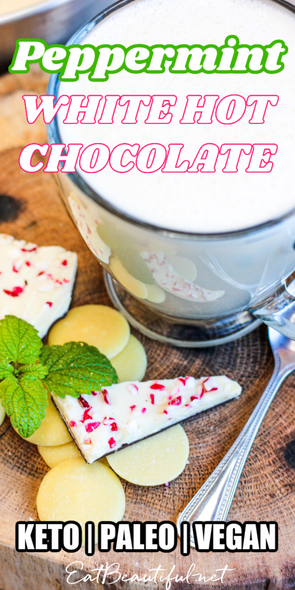 looking down on a peppermint white hot chocolate with cocoa butter and mint next to the mug