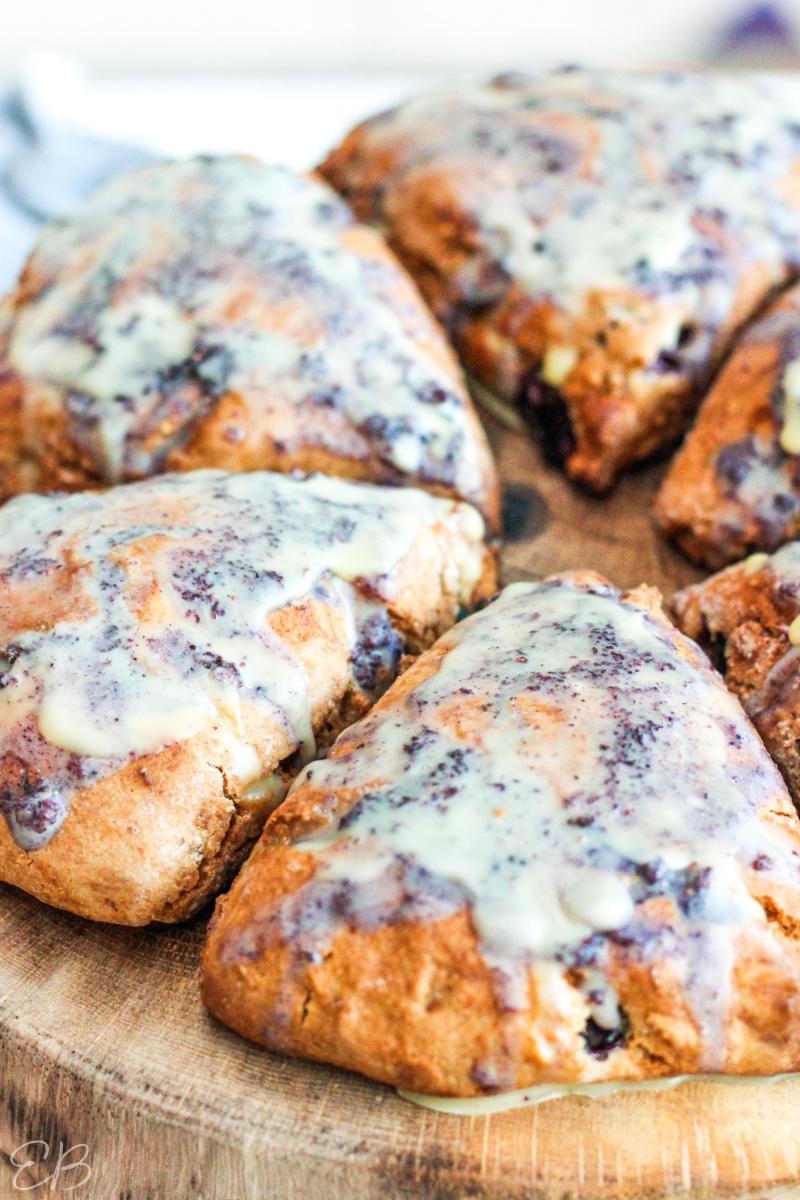 side angle of scones with blueberry glaze