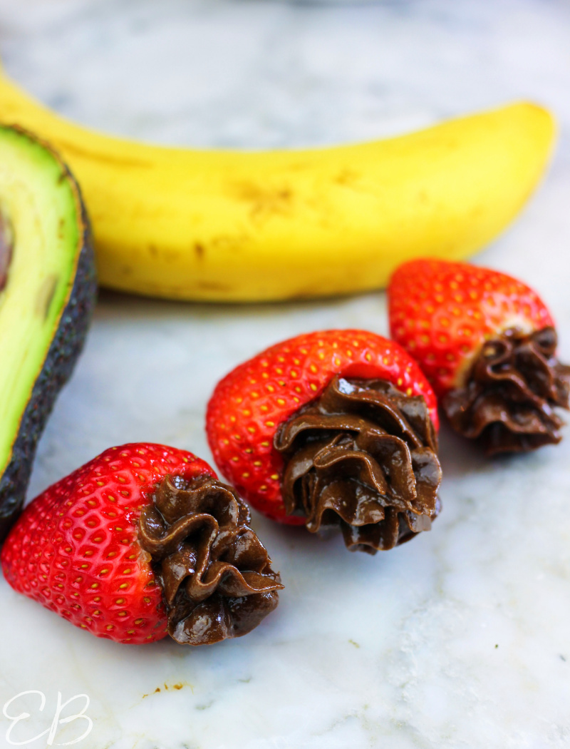 aip ganache variation with avocado and banana piped into strawberries