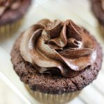 looking downward on cupcake with aip chocolate ganache on it